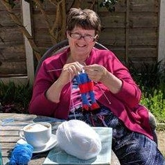 Lyn Knitting in Toby and Cheryls garden